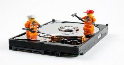 Lego workmen repairing a faulty hard drive